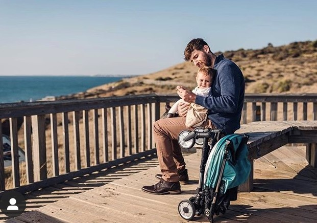 Nick and baby with stroller 2
